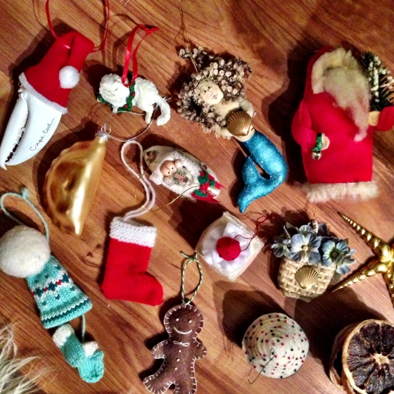 My collection of ornaments consists mostly of ones from my Aunt Sue, who bought me one every year until I was in my 20's, and my friend Jocelyn who's made me a bunch of lovely little felted desserts.